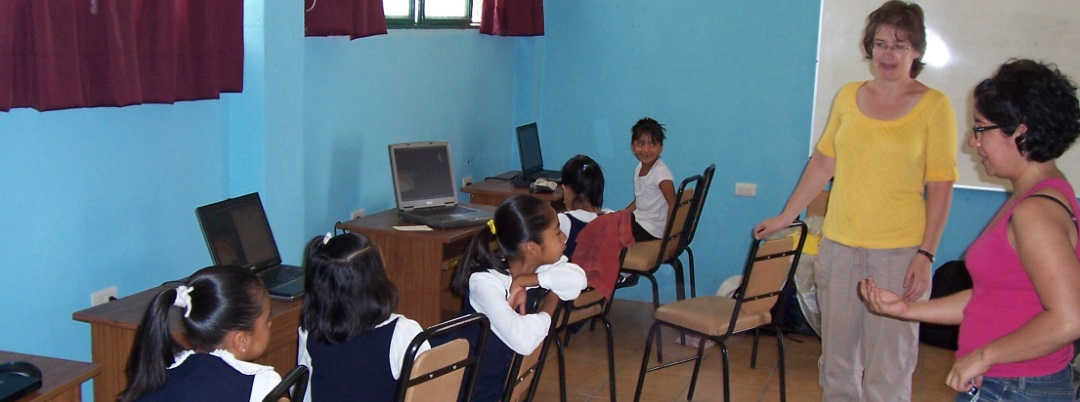 Kids on Computers volunteers and students at work in new KoC computer lab