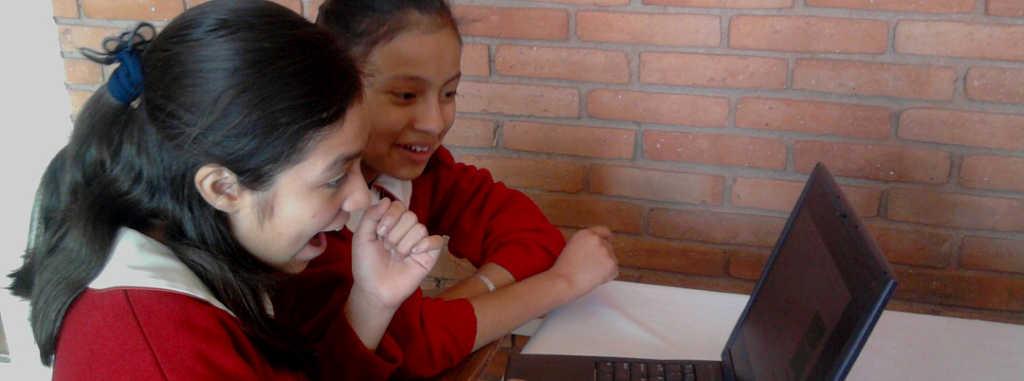 Two Girls with KoC supplied laptop at El Colegio Britanico, Mexico